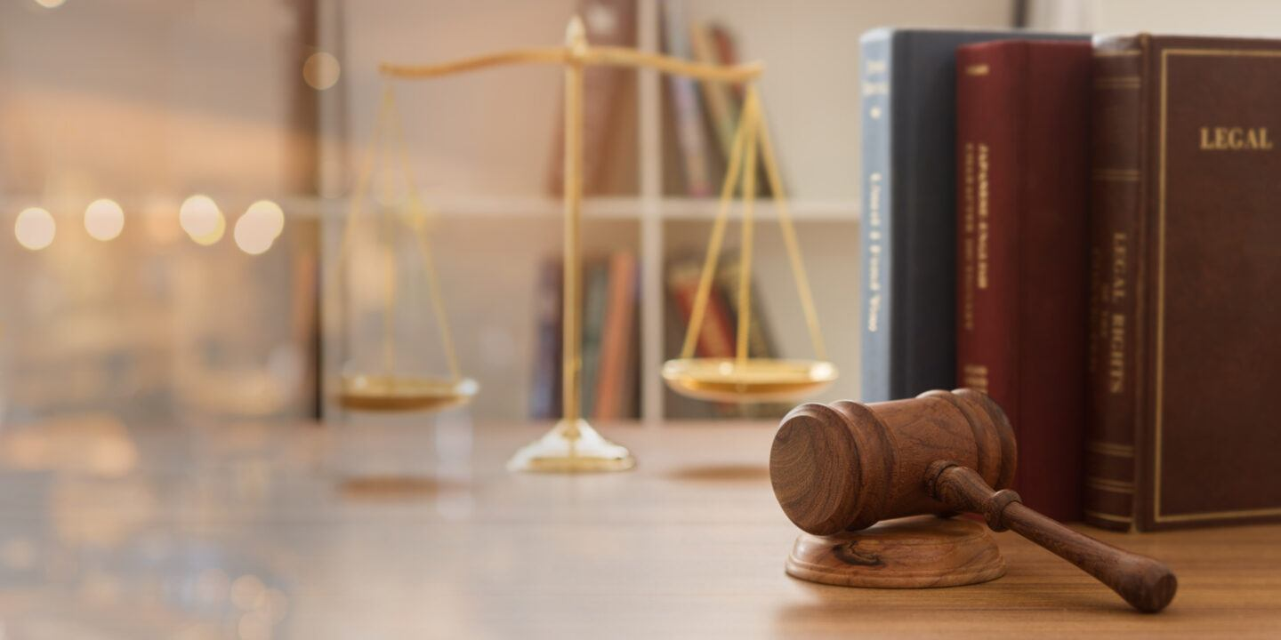 Judge gavel with law books and scales of justice. concept of justice, legal, jurisprudence. wide view.